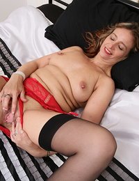 Horny shaved British housewife playing with herself
