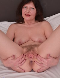 This naughty British housewife shows off her hairy bush